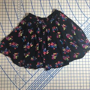 D'signed black with bright floral print xl skirt